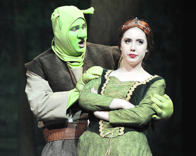 "Anthony Weber | Troy Daily News Braden Stafford portrays ""Shrek"" while Lauren Beagle portrays ""Fiona"" in a Tippecanoe High School production of ""Shrek the Musical."" Performances will be held at 7:30 p.m. Thursday-Saturday, and a matinee will be performed at 2:30 p.m. Sunday in the Tippecanoe Center for Performing Arts."
