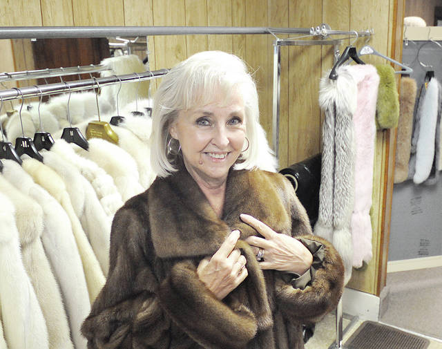 "Anthony Weber | Troy Daily News Roark Furs and Service Co. co-owner Linda Long displays one of many furs located at Roark Furs in Laura. ""It's been a lot of fun. We have the greatest customers in the world,"" co-owner Larry Day said."