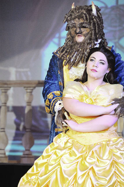 "Anthony Weber | Troy Daily News Mary Beth Fraley portrays Belle while Aedan Kennedy portrays the Beast in a School on the Rock production of ""Beauty and the Beast."" The musical opens tonight and will continue this weekend at the Hangar in Vandalia."