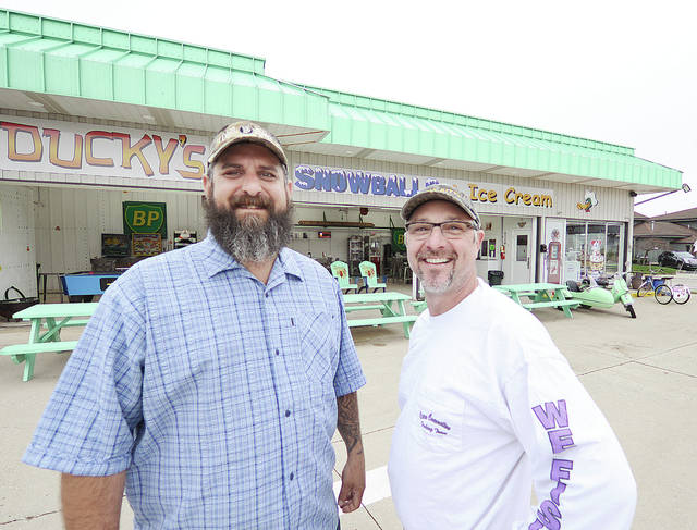 Anthony Weber | Troy Daily News Ducky's Snowballs and Ice Cream owners Mike Michetti, left, and Donald Butler stand outside their ice cream parlor Tuesday in Troy. The business offers 16 different Hershey hand-dipped flavors, 100 different snowball flavors, bayou blasts, stuffed snowballs as well as traditional treats. The shop will open Saturday at noon and will remain open April Fools to Halloween according to Butler and Michetti. Ducky's is located at 100 W. Market St.