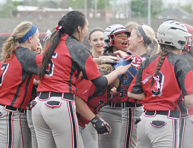 Anthony Weber/Troy Daily News file Troy's Natalie Henson is congratulated after hitting a home run last season. Henson was one of a large number of seniors graduating for last year's co-GWOC North champion team.