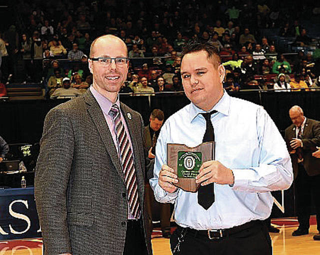 Photo Courtesy of the Southwest District Athletic Board Troy Junior High School principal and Southwest District Athletic Board Vice President David Dilbone (left) presents David Fong with the Ohio High School Athletic Association/Southwest District Media Award Saturday at halftime of the boys Division I district final at the University of Dayton Arena.