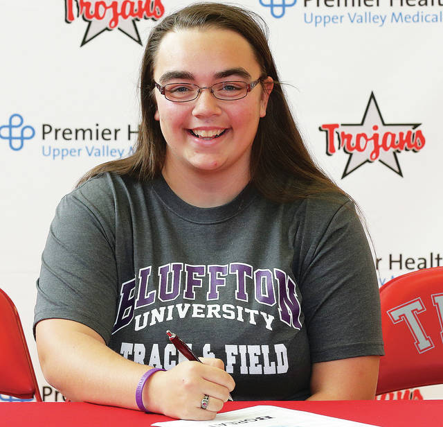 Photo Courtesy of Lee Woolery | Speedshot Photo Troy senior Amanda Setser signs her national letter of intent with Bluffton University.