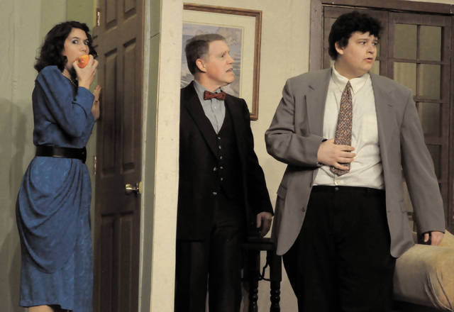 Cecilia Fox | Troy Daily News Maggie, played by Carly Risenhoover-Peterson, hides from her father, played by Jim Hooper, and opera star Tito Mirelli, played by Tyler Smith. The show opens Friday at 7 p.m. at Zion Lutheran Church in Tipp City.