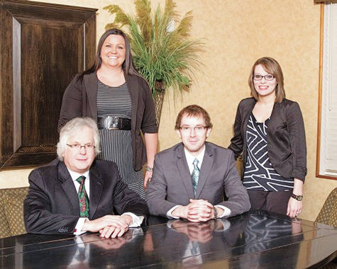 Provided photo Craig W. Mullenbrock, front left, has become an Ameriprise Financial Private Wealth Advisor. Here, he is shown with his team at Mullenbrock & Associates, located at 228 W. Ash St., Piqua.