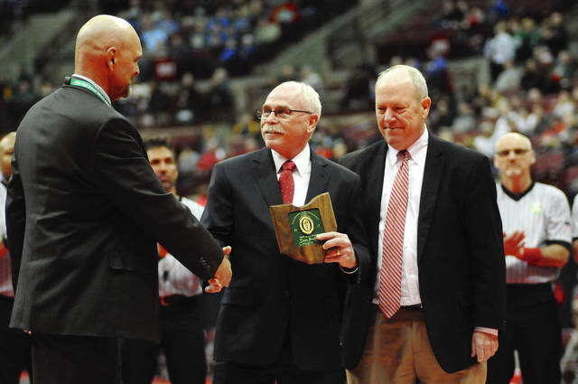 Ben Robinson/GoBuccs.com Covington wrestling coach Tom Barbee accepts the OHSAA Sportsmanship Ethics and Integrity Award at the state wrestling tournament last weekend.