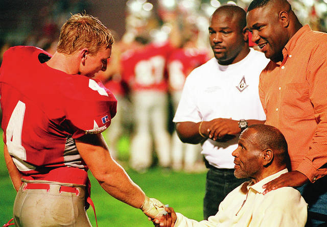 Rick Ramsey | Troy Daily News File Photo Ryan Brewer (left) and Bob Ferguson, shown here shaking hands after a 1998 Troy football game, both are members of the first class inducted into the Troy High School Athletic Hall of Fame. The hall of fame selection committee is asking community members to nominate potential future hall of fame members.