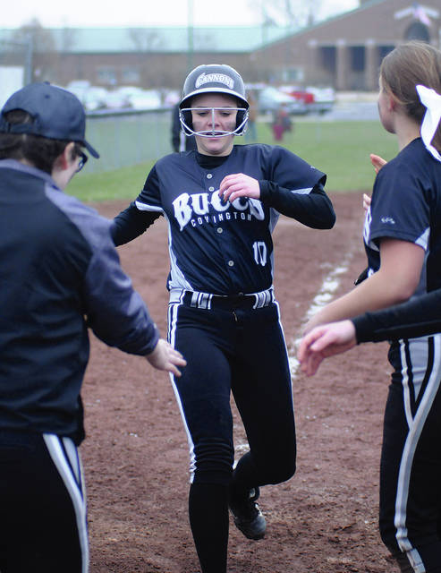 Ben Robinson/GoBuccs.com Covington's Mackenzie Long is congratulated as she crosses home plate after a home run Tuesday at Mississinawa Valley.