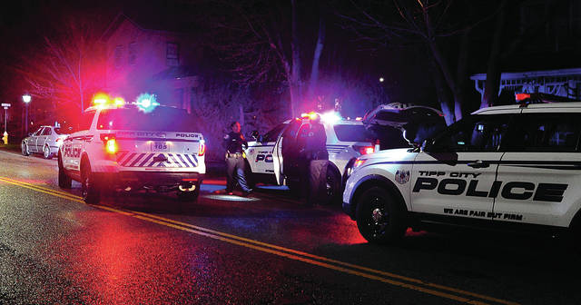 "Mike Ullery | Daily Call Tipp City Police Officers take multiple suspects into custody on West Main Street on Thursday night following a ""shots fired"" report at Tony's Bada-Bing bar."