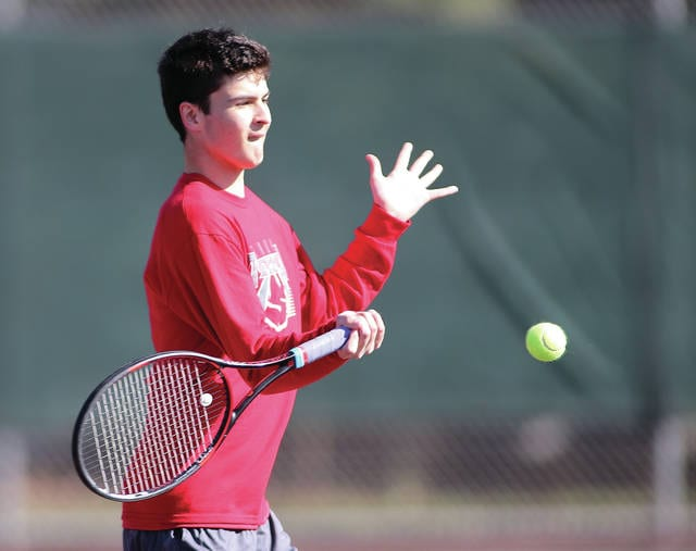 Photo courtesy Lee Woolery/Speedshot Photo Troy's Shane Essick hits a forehand Friday against Butler.