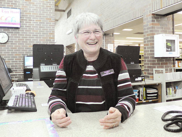 "Anthony Weber | Troy Daily News Troy-Miami County Public Library Circulation Associate Sandy Mitchell has retired after 29 years of service. ""I am going to miss the people. It's been such a family here,"" Mitchell said."