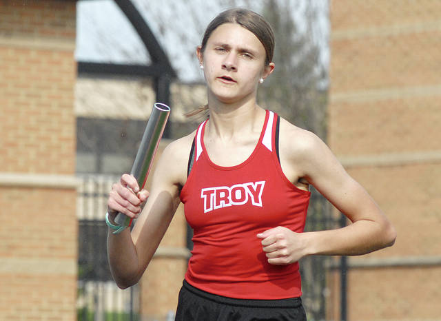 Anthony Weber/Troy Daily News Troy's Emma Shigley runs in the 4x800 relay Wednesday at the Herb Hartman Invitational.