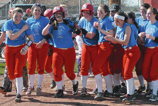 Anthony Weber/Troy Daily News Newton's Brooke Deeter is congratulated by her teammates after hitting a home run against Butler Saturday the Newton's Strike Out Cancer Classic tournament.