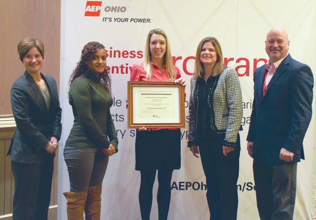 Provided photo Julie Birchfield, customer outreach manager for Energy Optimizers, USA, holds the Most Savings Achieved in 2016 award for the company's outstanding performance and contributions to AEP Ohio's energy efficiency programs.