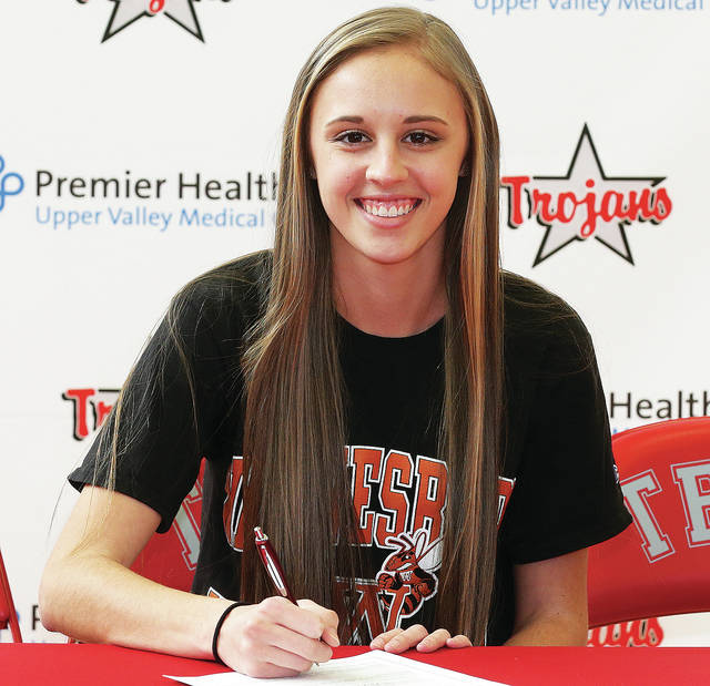 Photo Courtesy of Lee Woolery | Speedshot Photo Troy's Megan Studebaker signs her national letter of intent to run cross country and track at Waynesburg University.