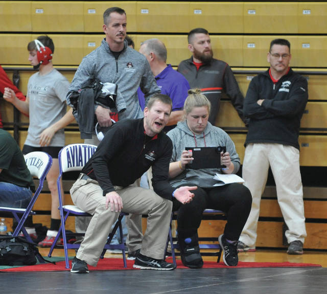 Josh Brown/Troy Daily News First-year Covington wrestling head coach Eric Vanderhorst gives instructions to one of his Buccaneers during the recent GMVWA Holiday Tournament at Butler High School.
