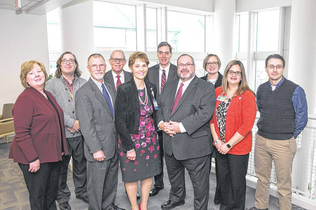 Provided photo: Pictured, from left to right: Kathleen Scarbrough, UVMC Foundation; Mike Bessler, Miami County Recovery Council; Rowan R. Nickol, MD, UVMC Hospital Board of Directors; Craig Bundschuh, UVMC Parent Board of Directors; Becky Rice, UVMC president; Michael Gutmann, iPIQUA Fund; Mark McDaniel, Tri-County Board of Recovery and Mental Health Services; Brenda Clemens, Miami County Dental Clinic; Heather Bolton, Ohio's Hospice of Miami County; and Justin Coby, Health Partners Free Clinic.
