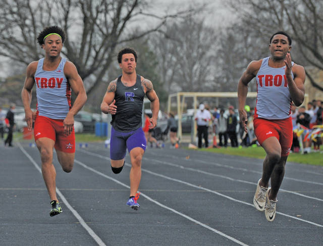 Josh Brown/Troy Daily News file Troy's Josh Browder (left) and Jaydon Culp-Bishop (right) run the 100 last season. After Browder's graduation, Culp-Bishop will be looked at to lead the Trojans' sprinters this year as the team's leading returning scorer.
