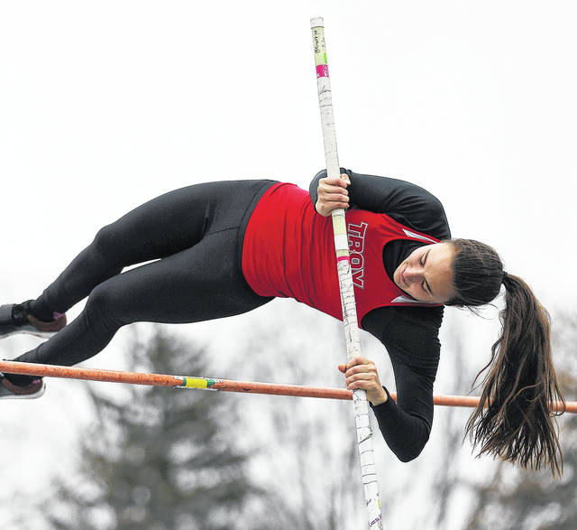 Photo courtesy Lee Woolery/Speedshot Photo Troy senior Christine Moser clears the bar in the pole vault during Wednesday's Up and Running Invitational at Troy Memorial Stadium.