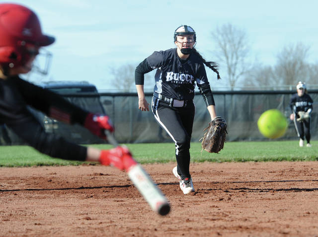 Mike Ullery | AIM Media Covington third baseman Kirstin Barnes rushes in to field a bunt Friday against Newton.