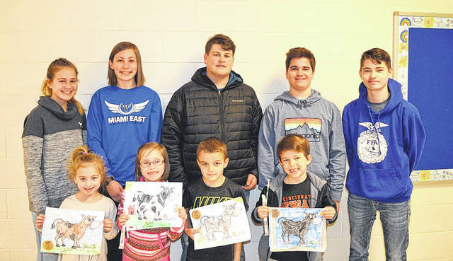 Provided photo Winners of the FFA's coloring contest for Miami East kindergartners were, front row, left to right, Savannah Moore, Lauren Landis, Colten Barnes, and Gambyl Spitler. FFA members on the Ag Literacy Committee were, back row, left to right, Anna Broerman, Sarah Blocher, Ethan Swindell, Coleman Demmitt and Carter Gilbert.