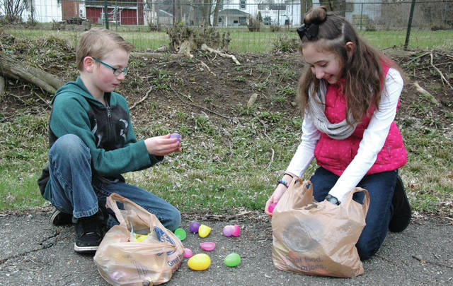 Cody Willoughby | Troy Daily News Brayden Humerick, 9, and Ryleigh Flint, 10, of Miami Township take stock of their bounty following the Annual Easter Egg Hunt at Lincoln Community Center on Saturday in Troy. Hundreds of children participated in the free event, hunting for thousands of eggs on the Lincoln Community Center property. For more information, visit www.lcctroy.com.