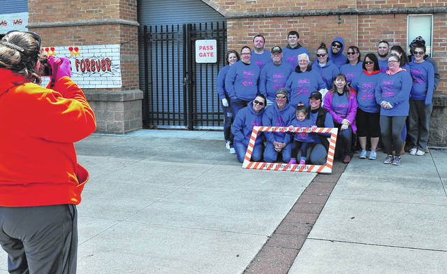 Mike Ullery | Daily Call Team Mayberry pauses for a team photo shortly after the start of Sunday's MS Walk in Troy. The team took part in the event to support Fred Mayberry of Piqua who has been fighting the disease for the past 11 years.