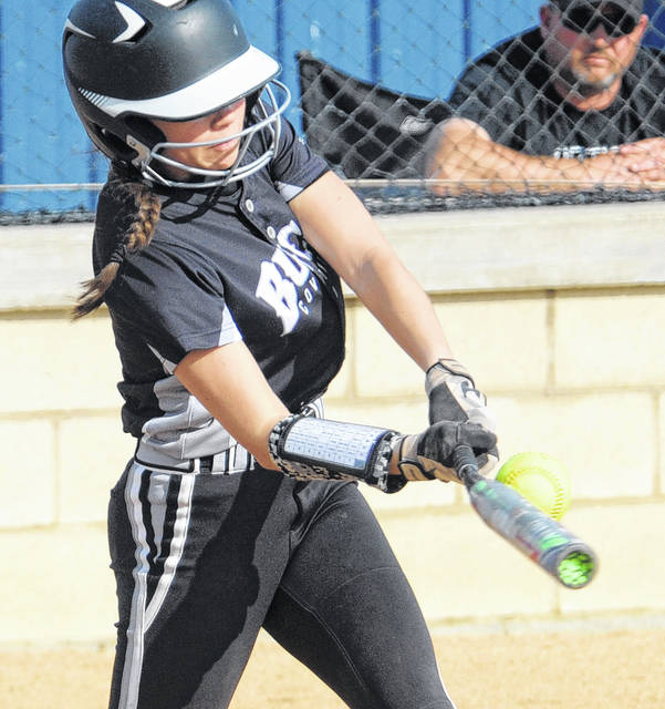 Mike Ullery/AIM Media Covington's Kenzie Long gets the bat on the ball Friday against Miami East.