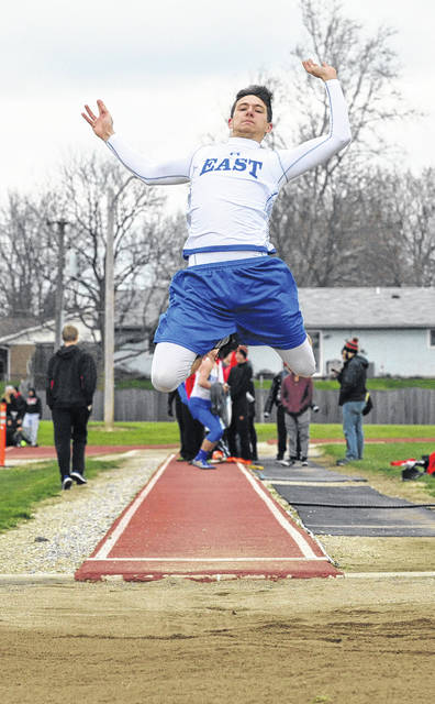 Josh Brown/Troy Daily News Miami East's Justin Brown wins the long jump during Tuesday's Miami County Championships at Tippecanoe Middle School.