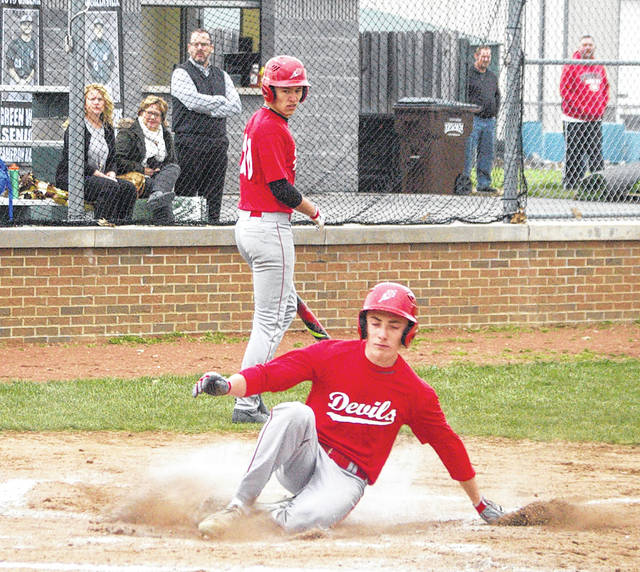 Kyle Shaner/AIM Media Tippecanoe's Mason McClurg scores a run during Wednesday's win at Greenville.
