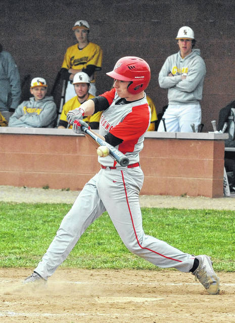 Josh Brown/Troy Daily News Tippecanoe's Mason McClurg makes contact on the go-ahead RBI single during Saturday's win over Kenton Ridge.