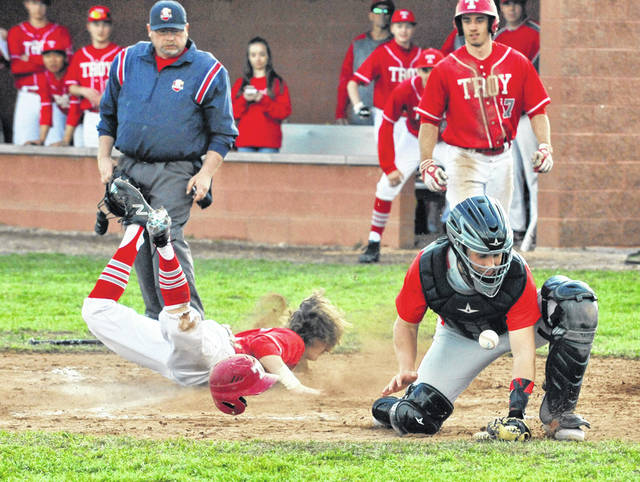 Josh Brown/Troy Daily News Troy's Brandon Emery slides in safely at home as Tippecanoe catcher Cade Beam fields the late throw in Wednesday at Tippecanoe Middle School.
