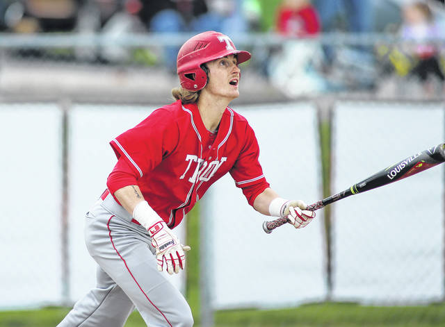 Photo courtesy Lee Woolery/Speedshot Photo Troy senior Brandon Emery follows through on a first-inning home run during a Senior Day game Saturday against Miamisburg at Market Street Field.