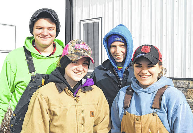 Provided photo Members of the the Miami East-MVCTC FFA Dairy Cattle evaluation team are, left to right, Ethin Bendickson, Chloee Thomas, Michael Bair and Elizabeth Bair.