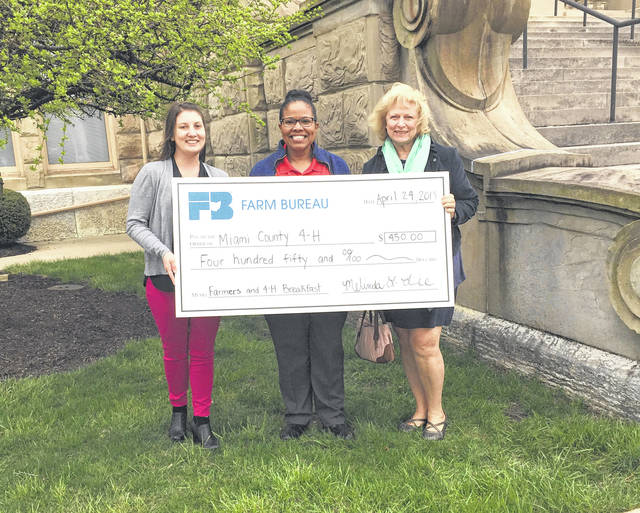 Provided photo Pictured, left to right, are Melinda Lee, organization director Miami County Farm Bureau; Demetria Woods, extension educator, 4-H Youth Development; and Cynda Shuman-Renner, Miami County Farm Bureau board member.