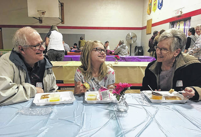 Tori Cockrell, 10, of Troy enjoys breakfast with grandparents Ron and Jill McMullen during the Grandparents Day breakfast on Friday at Hook Elementary School in Troy.