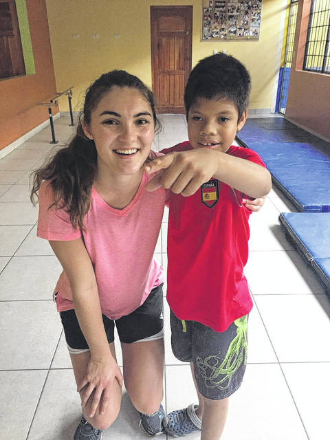 Provided photo In Nicaragua, Troy Christian senior Brittany Swartz and other Troy Christian students had the opportunity to visit an orphanage for disabled children and adults, paint and help make a wall at a translator's home, and mix concrete for a shelter for families who were settled there from a dump called Chacocente.