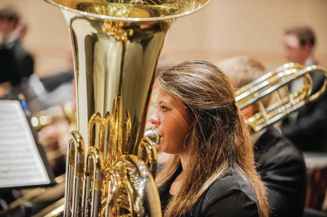 "Provided Photo Troy native Courtney Carmack plays sousaphone with the Dayton Philharmonic Youth Orchestra. Carmack was recently part of the 2018 NCAA tournament, in which her pep band at Loyola University Chicago made it to the ""Final Four""."