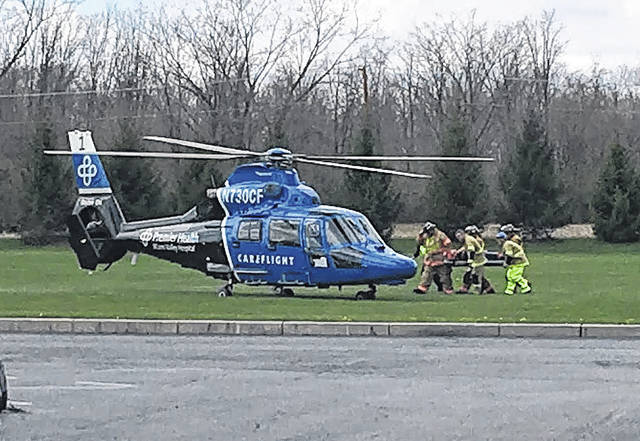 Cody Willoughby | Troy Daily News Careflight officials prepare to load an injured passenger during a mock crash staged at Tippecanoe High School on Thursday.