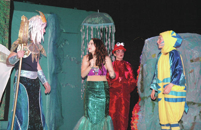 "Cody Willoughby | Troy Daily News Left to right, Trent Bianco as King Triton, Ava Linder as Ariel, Hannah Schaffnit as Sebastian, and Kelsey Sisco as Flounder engage in an undersea confrontation in Troy Christian High School's spring production of ""The Little Mermaid."""