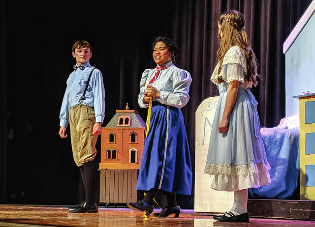 "Cecilia Fox | Troy Daily News Mary Poppins, played by Samantha del Rosario, measures up the Banks children, Alaina Yarwick and Ean Bosma, before declaring herself to be ""practically perfect in every way."""
