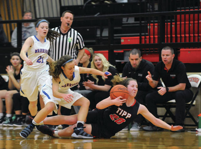 Josh Brown/Troy Daily News file Tippecanoe's Claire Hinkle dives for a loose ball in front of the Red Devil bench during a Division II sectional tournament game against Northwestern this winter season at Tecumseh High School.