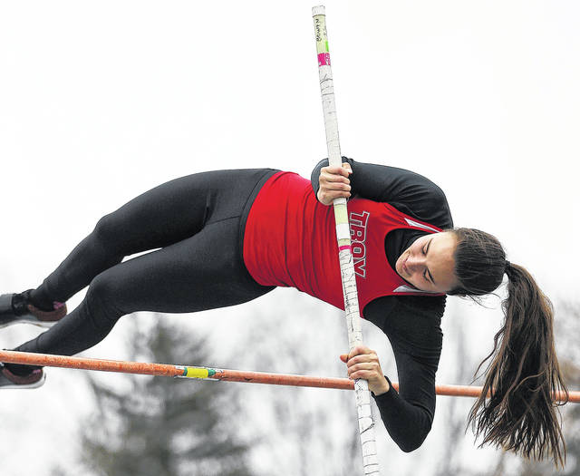 Photo Courtesy of Lee Woolery | Speedshot Photo Troy senior Christine Moser clears the bar in the pole vault during a meet earlier this season.