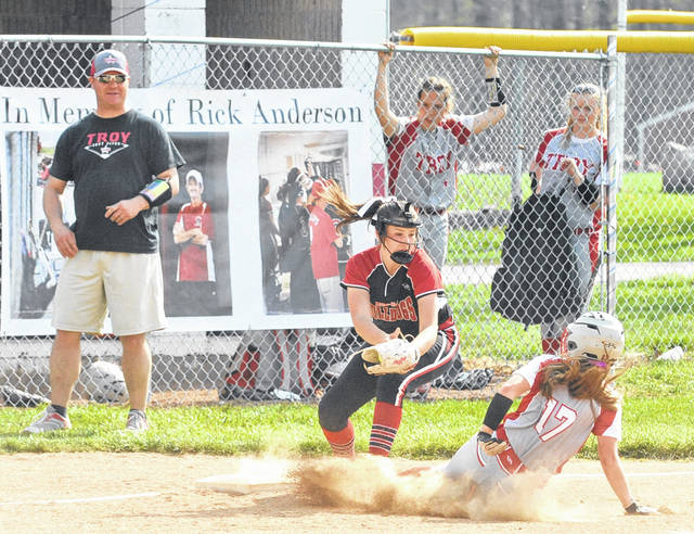 Josh Brown/Troy Daily News Milton-Union third baseman Kya Swartztrauber tags out Troy Megan Malott trying to steal third in the first inning Wednesday at Milton-Union