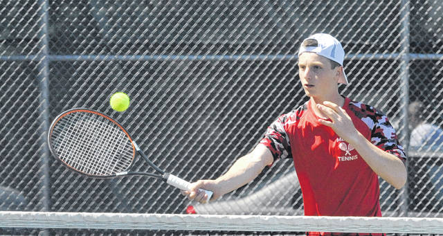 Josh Brown/Troy Daily News Milton-Union's Nathan Brumbaugh hits a volley at the net at the Division II sectional tournament Tuesday.