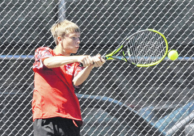 Josh Brown/Troy Daily News file Milton-Union's Nick Brumbaugh hits a backhand during the Division II sectional tournament in Troy this season.