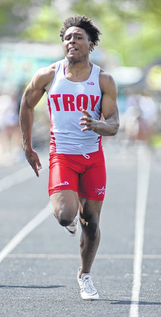 Photo courtesy Lee Woolery/Speedshot Photo Troy's Jaydon Culp-Bishop runs the 100 during Wednesday's Greater Western Ohio Conference Division Meet at Troy Memorial Stadium.