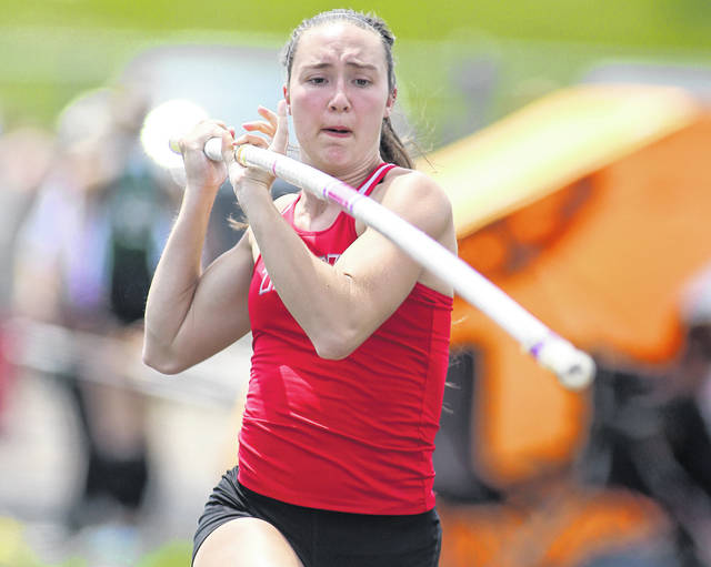 Photo Courtesy of Lee Woolery | Speedshot Photo Troy pole vaulter Christine Moser recently cleared 12-feet in winning the overal Greater Western Ohio Conference title, the second-highest vault in school history. She'll take aim at the school record of 12-4 in the coming weeks.