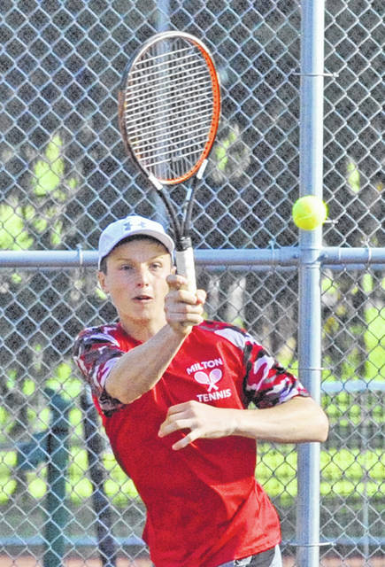 Josh Brown/Troy Daily News Milton-Union's Nathan Brumbaugh follows through on a running forehand at the Division II sectional tournament Saturday at Troy Community Park.