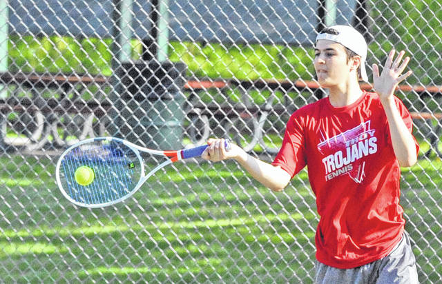 Josh Brown/Troy Daily News Troy's Shane Essick hits a forehand at the Division I sectional tournament Saturday at Troy Community Park.